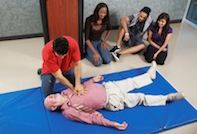 Students performing CPR on a dummy